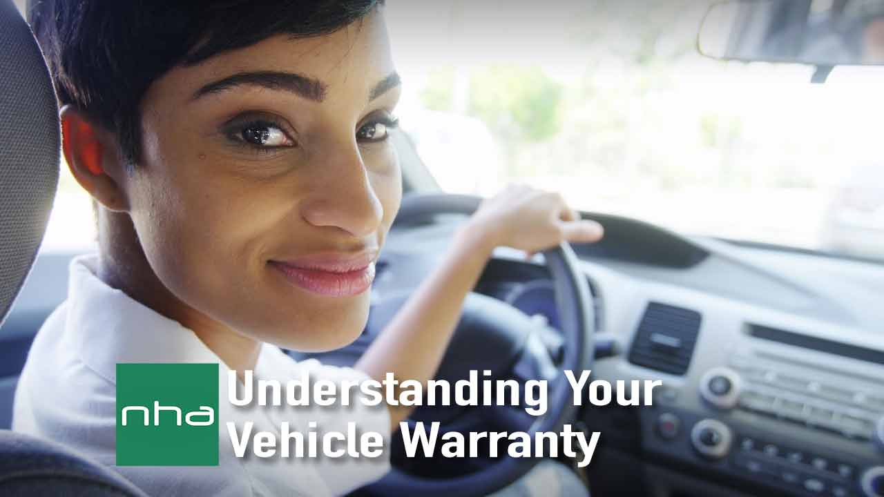 Woman behind the wheel confident in her vehicle warranty